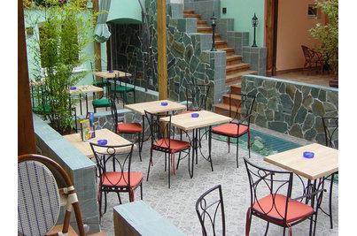 Pizzerie Padova - Pizzerie Padova s kovaným nábytkem